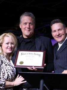 Dr Rodney J. Mock with his wife Stacy and Dr. Jeremy Swizek of SBTSU